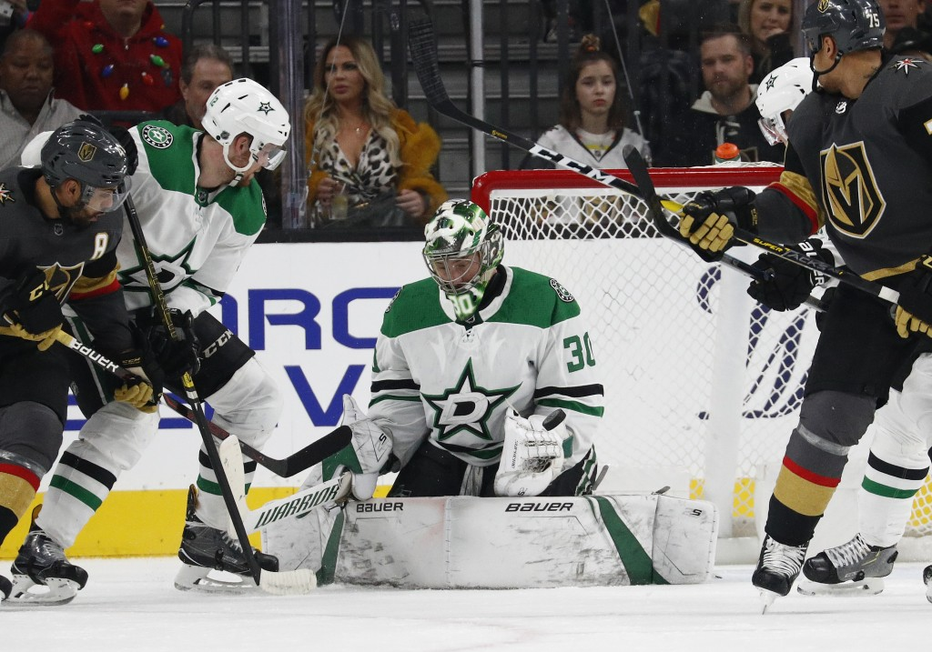 Dallas Stars goaltender Ben Bishop (30) makes a save against the Vegas Golden Knights during the first period of an NHL hockey game Sunday, Dec. 9, 20