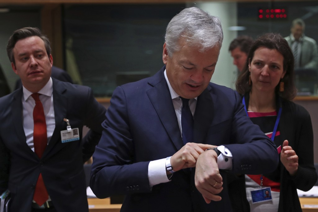 Belgium's Foreign Minister Didier Reynders looks at his watch prior a meeting of EU Foreign Affairs ministers at the European Council headquarters in ...