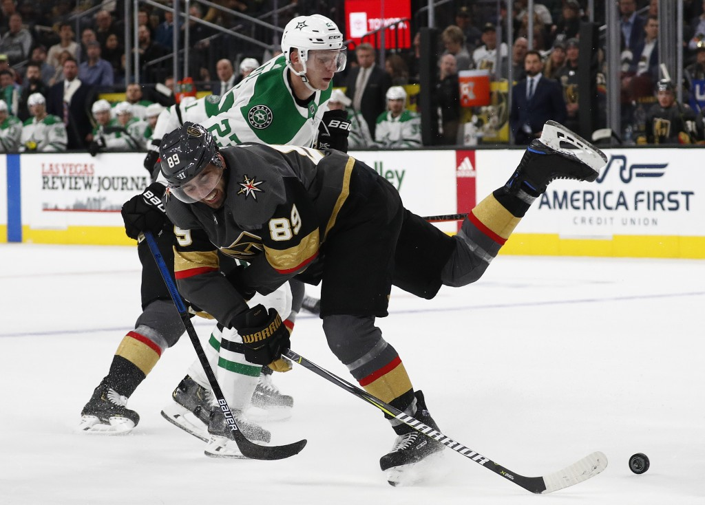 Vegas Golden Knights right wing Alex Tuch (89) vies for the puck with Dallas Stars defenseman Esa Lindell (23) during the second period of an NHL hock...
