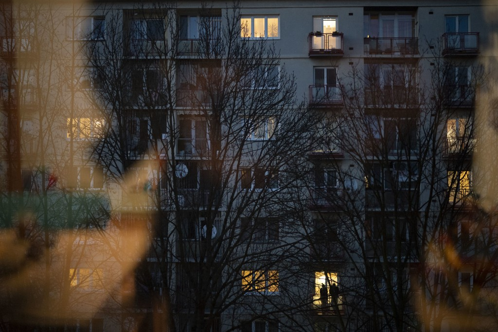 In this Nov. 11, 2018, photo, a couple stands on the balcony of their apartment in Zilina, Slovakia. An investigation by The Associated Press has foun...