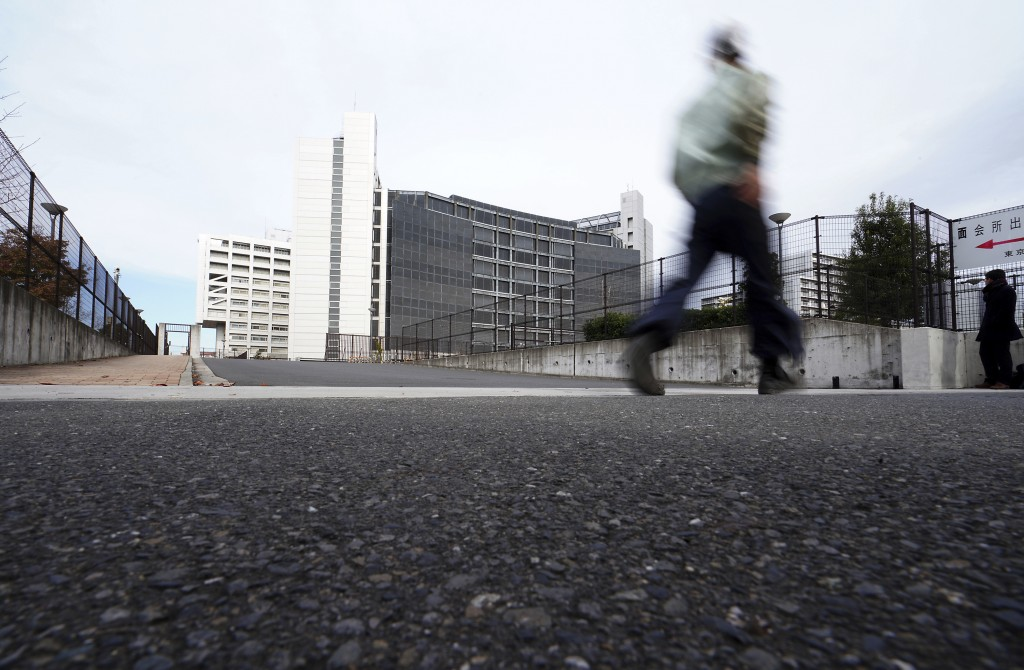 A man walks past outside Tokyo Detention Center where former Nissan chairman Carlos Ghosn is being detained Monday, Dec. 10, 2018, in Tokyo. Tokyo pro...
