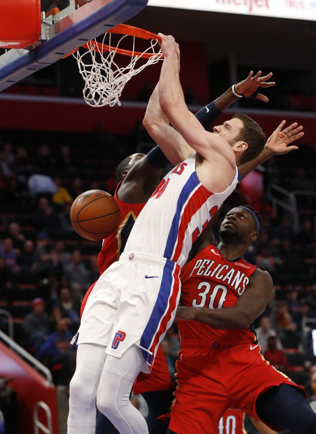 Detroit Pistons forward Jon Leuer (30) dunks against New Orleans Pelicans forward Cheick Diallo in the first half of an NBA basketball game in Detroit...