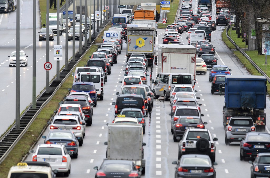 Cars queue on a street in Munich, southern Germany, Monday, Dec. 10, 2018. A German-wide strike of the train workers forced thousands of commuters to