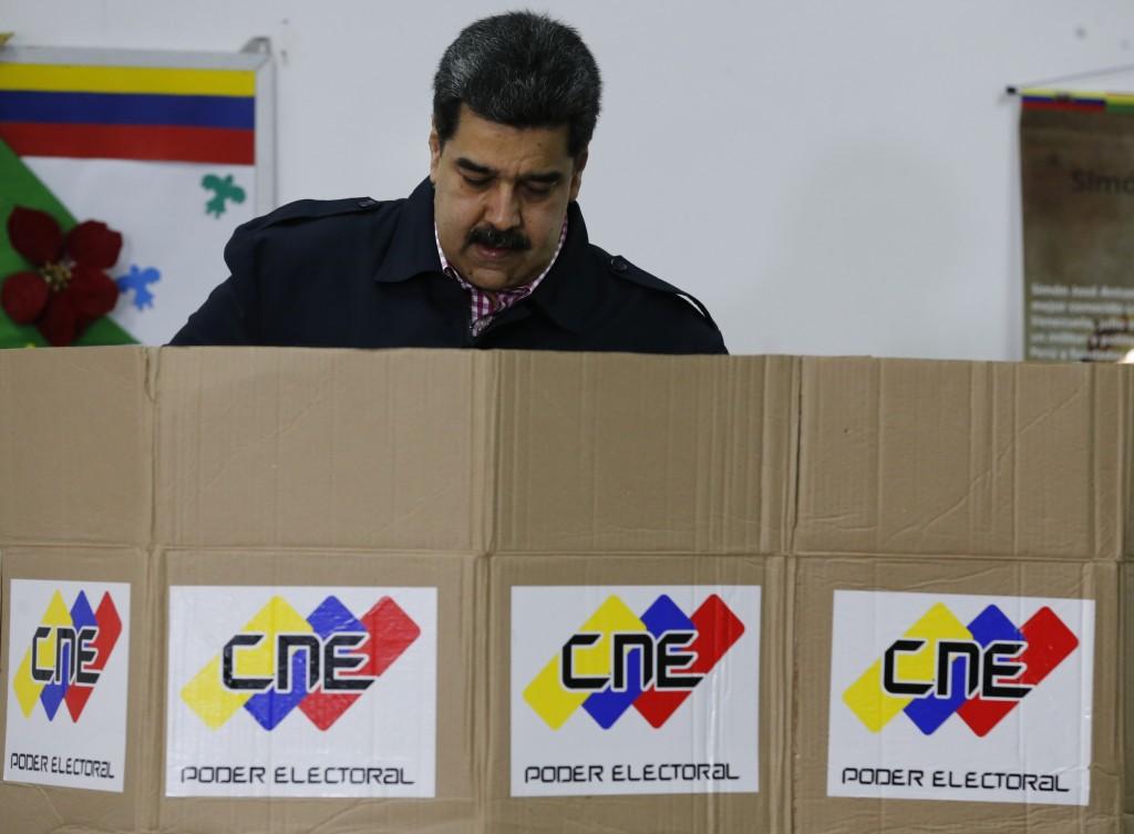 Venezuela's President Nicolas Maduro votes during local elections in Caracas, Venezuela, Sunday, Dec. 9, 2018. Venezuelans head to the polls Sunday to...