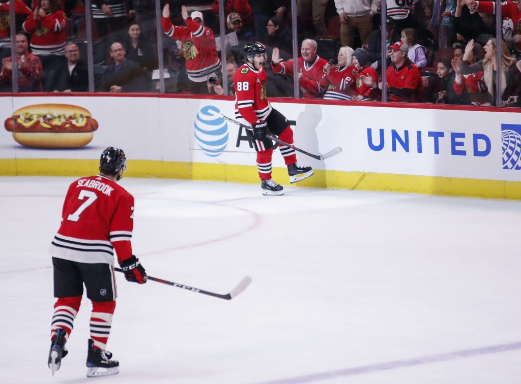 Chicago Blackhawks right wing Patrick Kane (88) reacts after scoring against the Montreal Canadiens during the first period of an NHL hockey game Sund