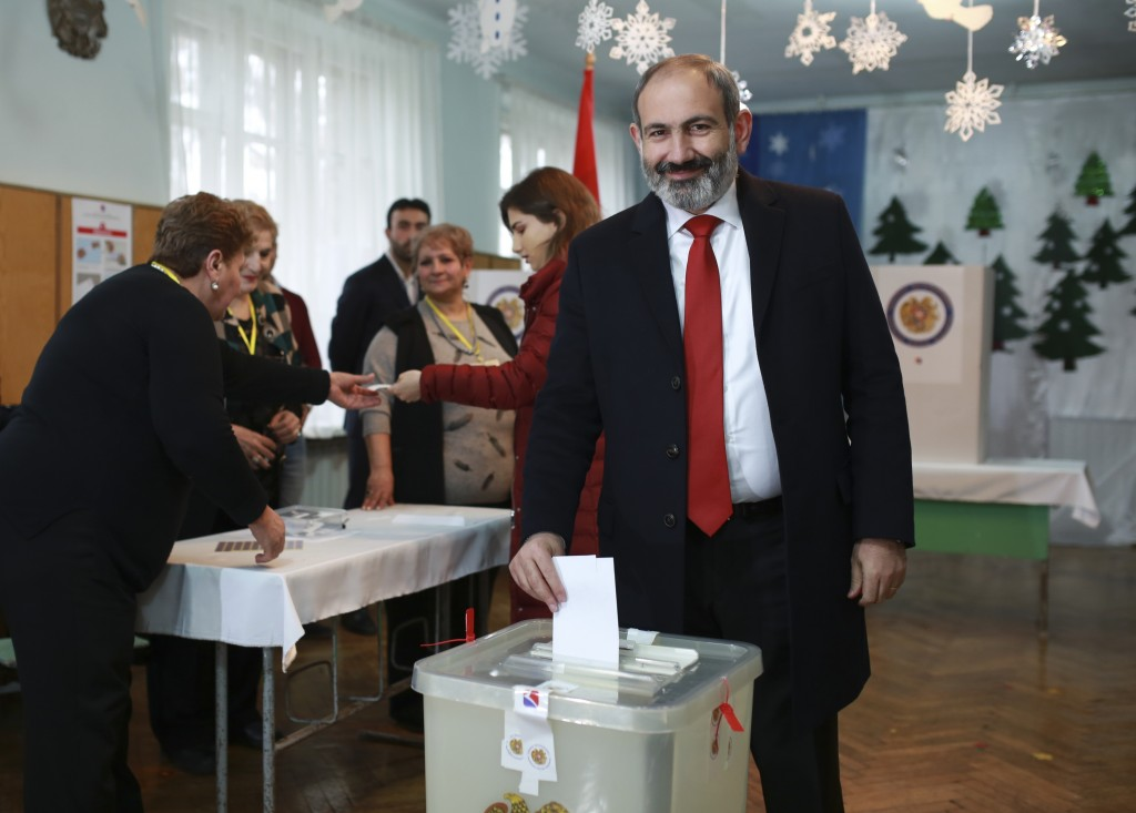 Acting Armenian Prime Minister Nikol Pashinian casts his ballot in a polling station during an early parliamentary election in Yerevan, Armenia, Sunda...
