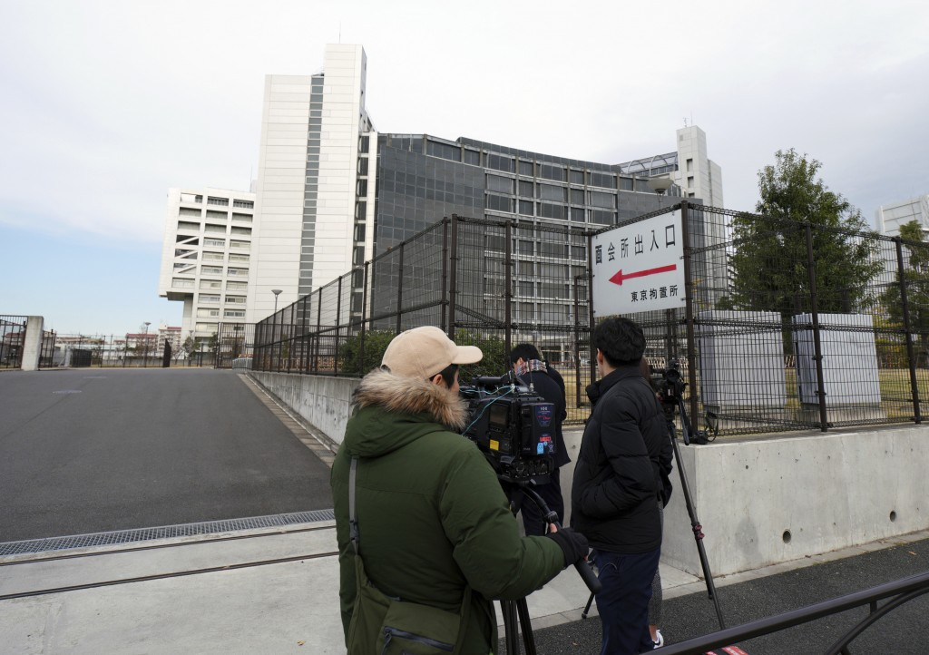 Journalists stand outside Tokyo Detention Center where former Nissan chairman Carlos Ghosn is being detained, Monday, Dec. 10, 2018, in Tokyo. Tokyo p...