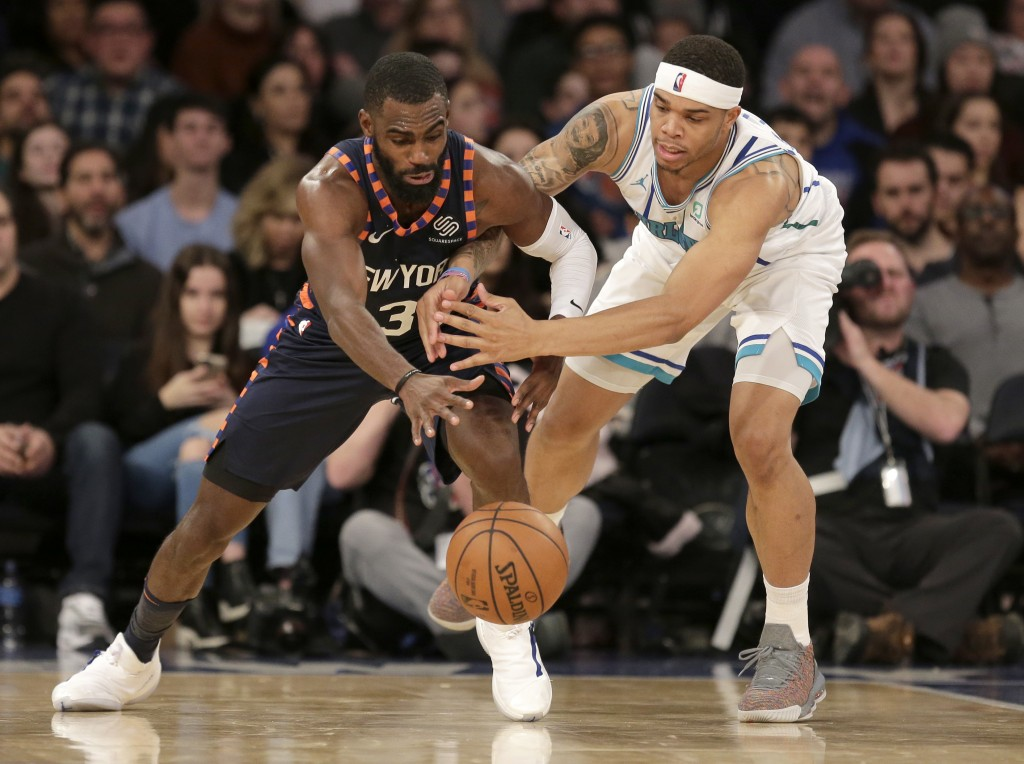 New York Knicks' Tim Hardaway Jr., left, and Charlotte Hornets' Miles Bridges fight for the ball during the second half of the NBA basketball game, Su...