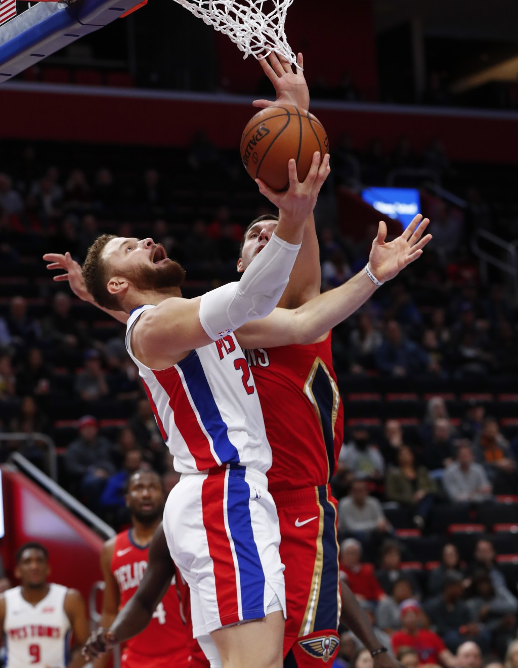 Detroit Pistons forward Blake Griffin (23) drives on New Orleans Pelicans forward Nikola Mirotic (3) in the first half of an NBA basketball game in De...