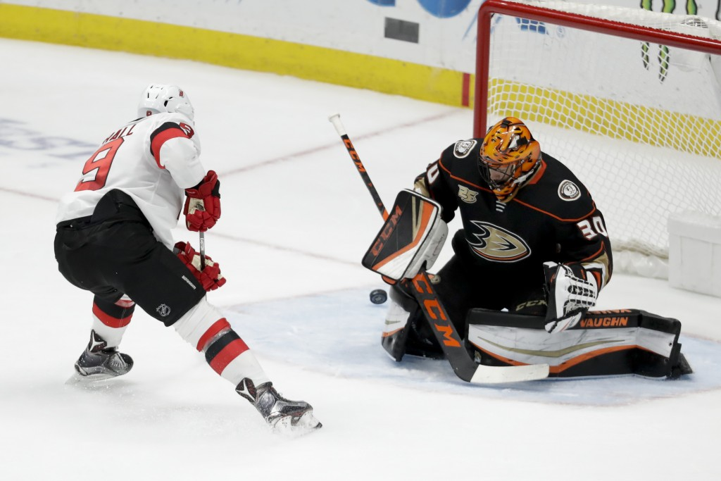 Anaheim Ducks goaltender Ryan Miller blocks a shot by New Jersey Devils left wing Taylor Hall during the second period of an NHL hockey game in Anahei