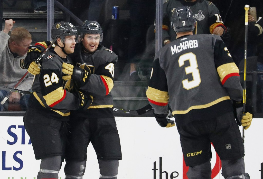 Vegas Golden Knights' Oscar Lindberg (24) celebrates after Ryan Carpenter (40) scored against the Dallas Stars during the first period of an NHL hocke...