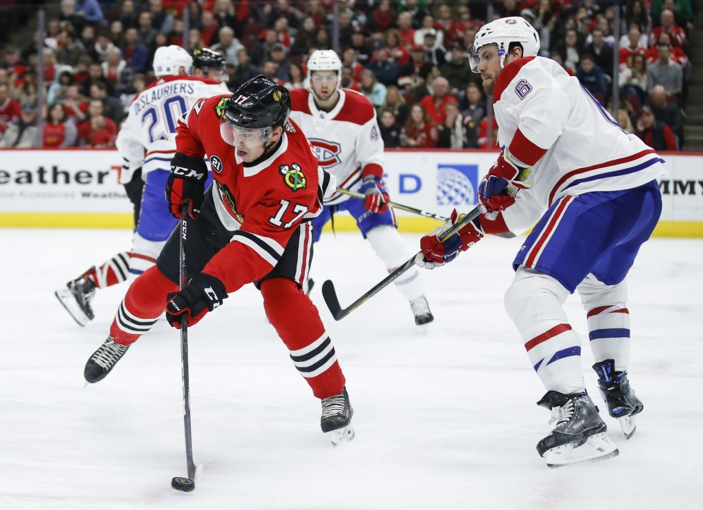 Chicago Blackhawks center Dylan Strome (17) passes the puck away from Montreal Canadiens defenseman Shea Weber (6) during the second period of an NHL ...