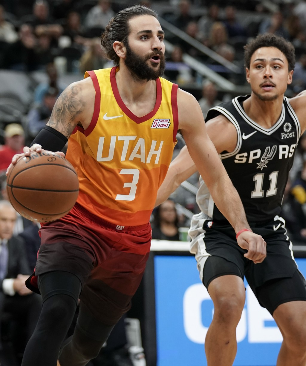 Utah Jazz guard Ricky Rubio (3) drives around San Antonio Spurs guard Bryn Forbes during the first half of an NBA basketball game, Sunday, Dec. 9, 201