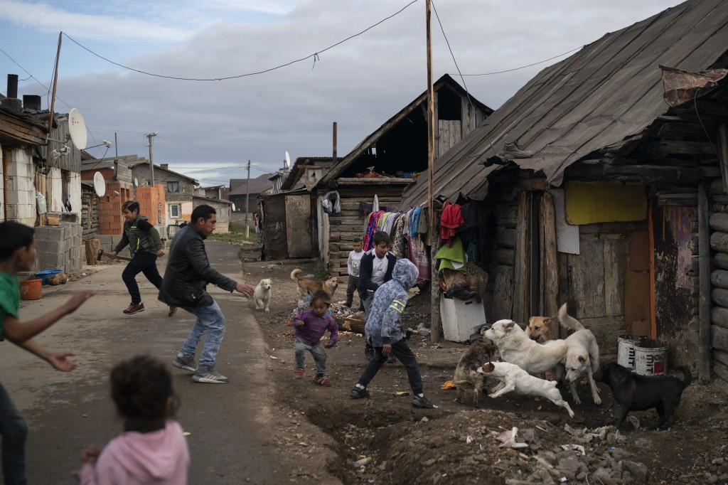 In this Nov. 12, 2018, photo, people run during a dog fight in a village near Kezmarok, Slovakia. An investigation by The Associated Press has found t...