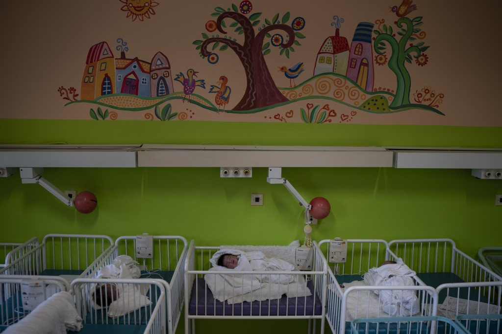 In this Nov. 16, 2018, photo, three babies whose mothers absconded the hospital, rest in their cribs at the Kezmarok hospital in Kezmarok, Slovakia. A