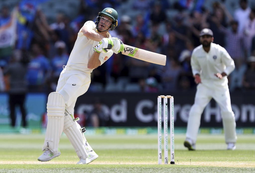 Australia's Tim Paine plays pull shot while batting on the final day of the first cricket test between Australia and India in Adelaide, Australia,Mond...