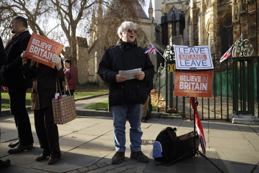 "A leave the European Union, Brexit supporter protests by saying he was ""taking a stand"" across the street from the House of Parliament in London, Tues"