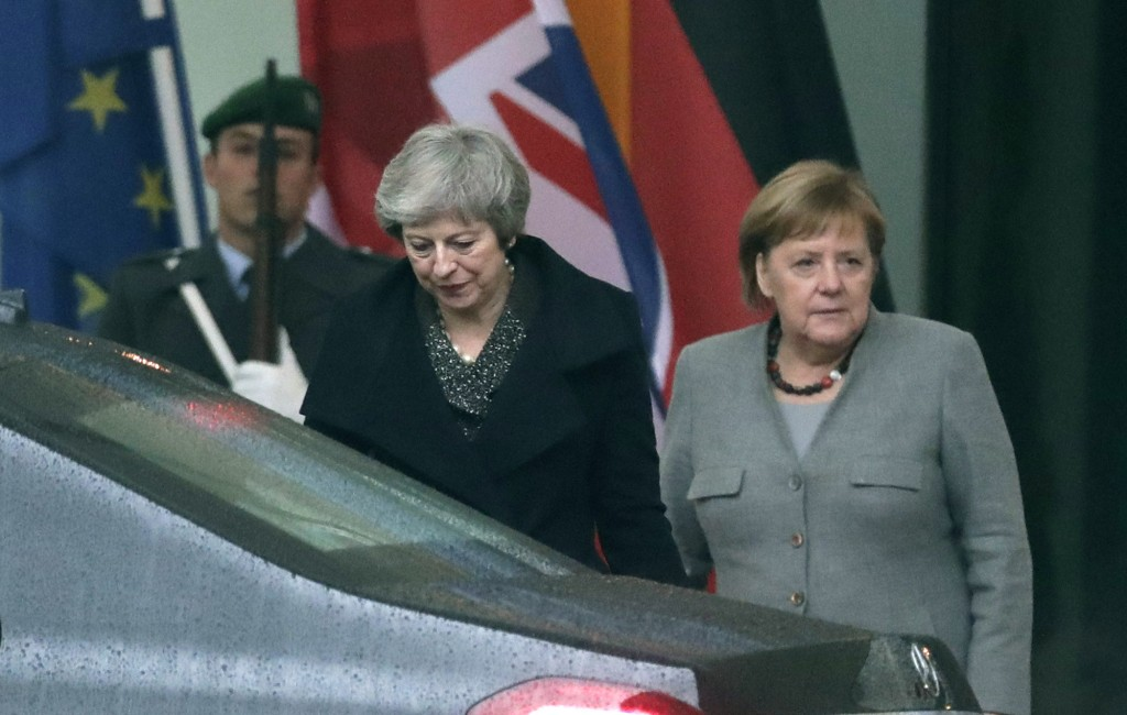 British Prime Minister Theresa May, center, leaves after a meeting with German Chancellor Angela Merkel, right, in the chancellery in Berlin, Germany,