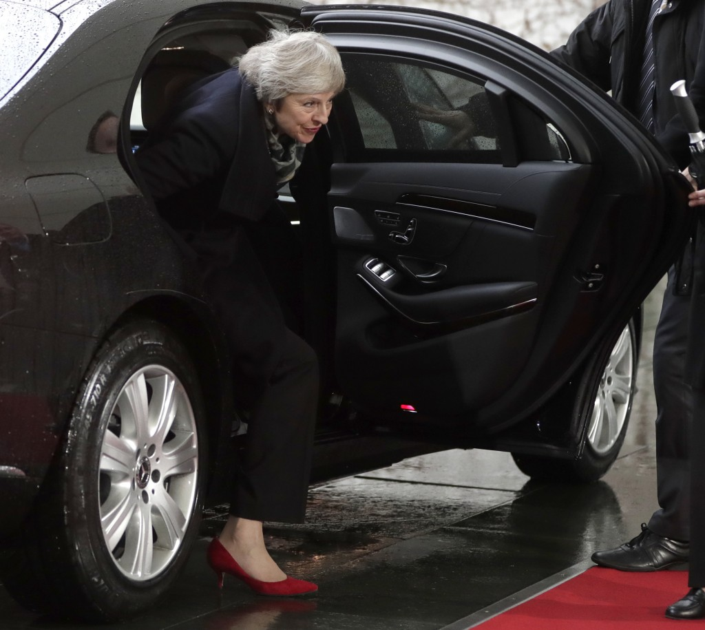 British Prime Minister Theresa May arrives for a meeting with German Chancellor Angela Merkel in the chancellery in Berlin, Germany, Tuesday, Dec. 11,