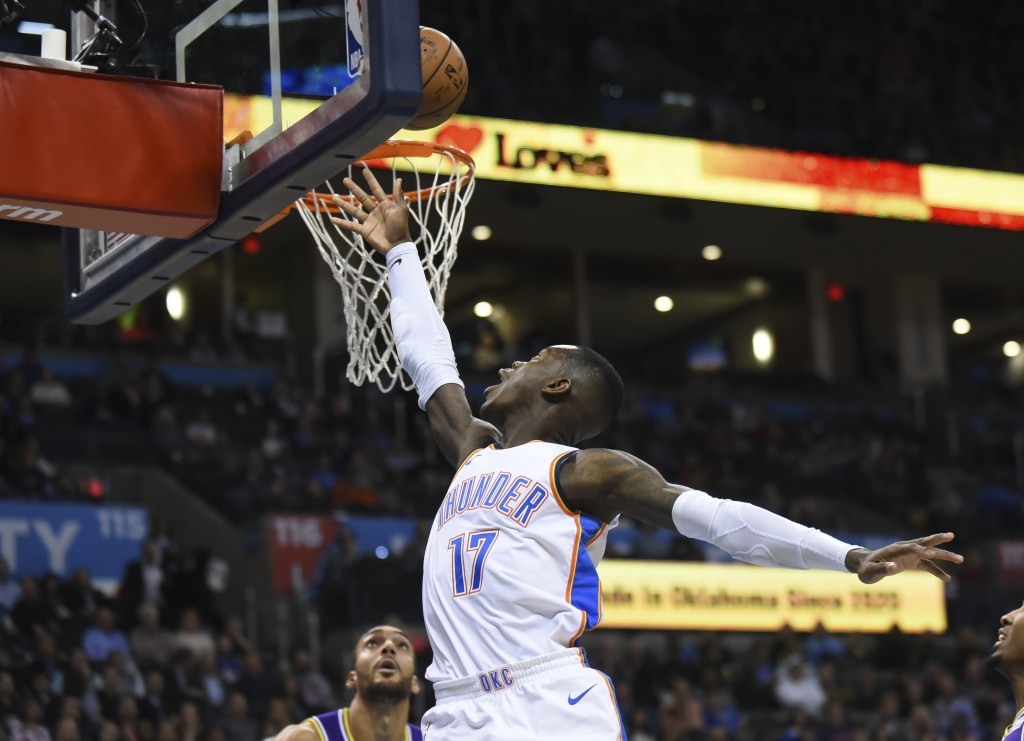 Oklahoma City Thunder guard Dennis Schroder goes in to shoot in the first half of an NBA basketball game against the Utah Jazz in Oklahoma City, Monda...