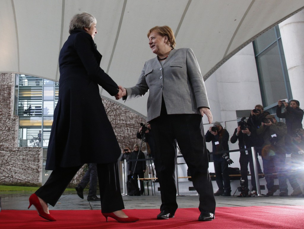 German Chancellor Angela Merkel, right, welcomes British Prime Minister Theresa May prior to a meeting in the chancellery in Berlin, Germany, Tuesday,