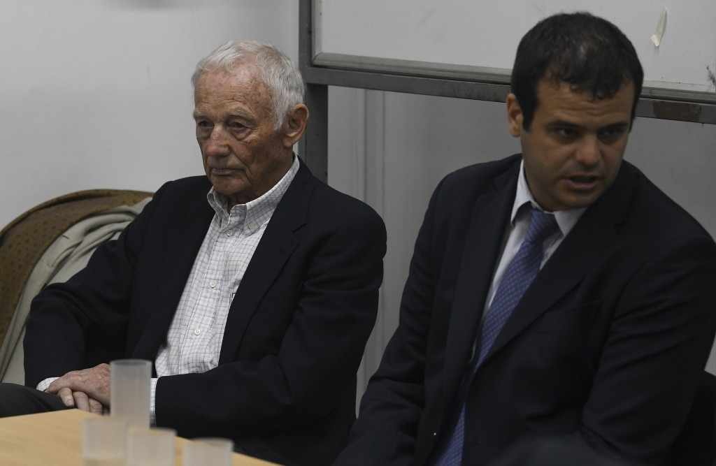 Former Ford Motor Co. executive Pedro Muller, left, who is charged with crimes against humanity for allegedly targeting Argentine union workers for ki