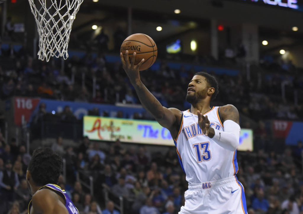 Oklahoma City Thunder forward Paul George goes in for a shot in the first half of an NBA basketball game against the Utah Jazz in Oklahoma City, Monda...