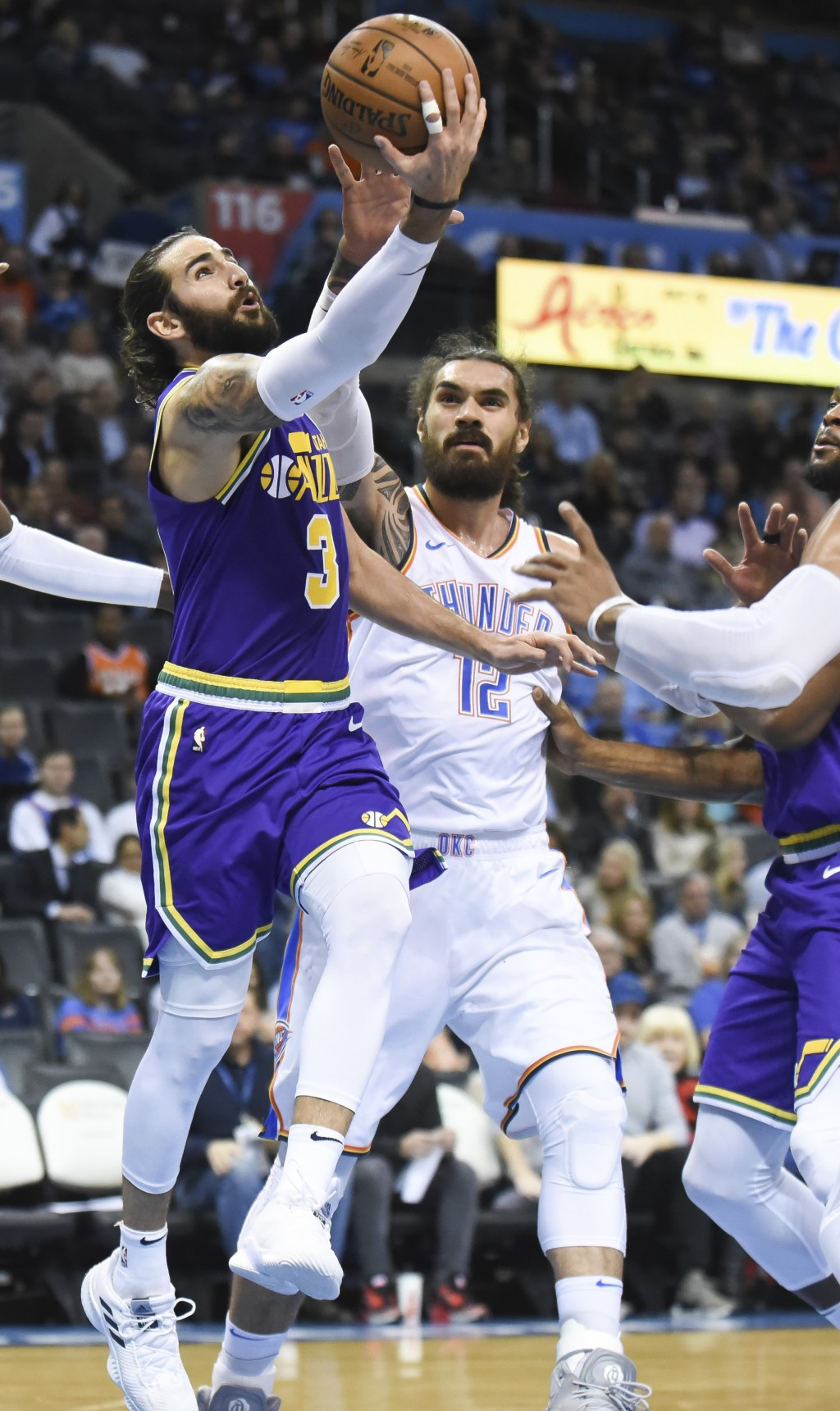 Utah Jazz guard Ricky Rubio (3) goes up to shoot past Thunder center Steven Adams (12) in the second half of an NBA basketball game in Oklahoma City, ...