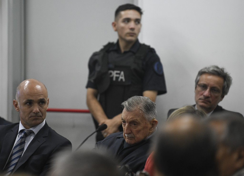 Former Ford Motor Co. executive Hector Sibilla, center, who is charged with crimes against humanity for allegedly targeting Argentine union workers fo