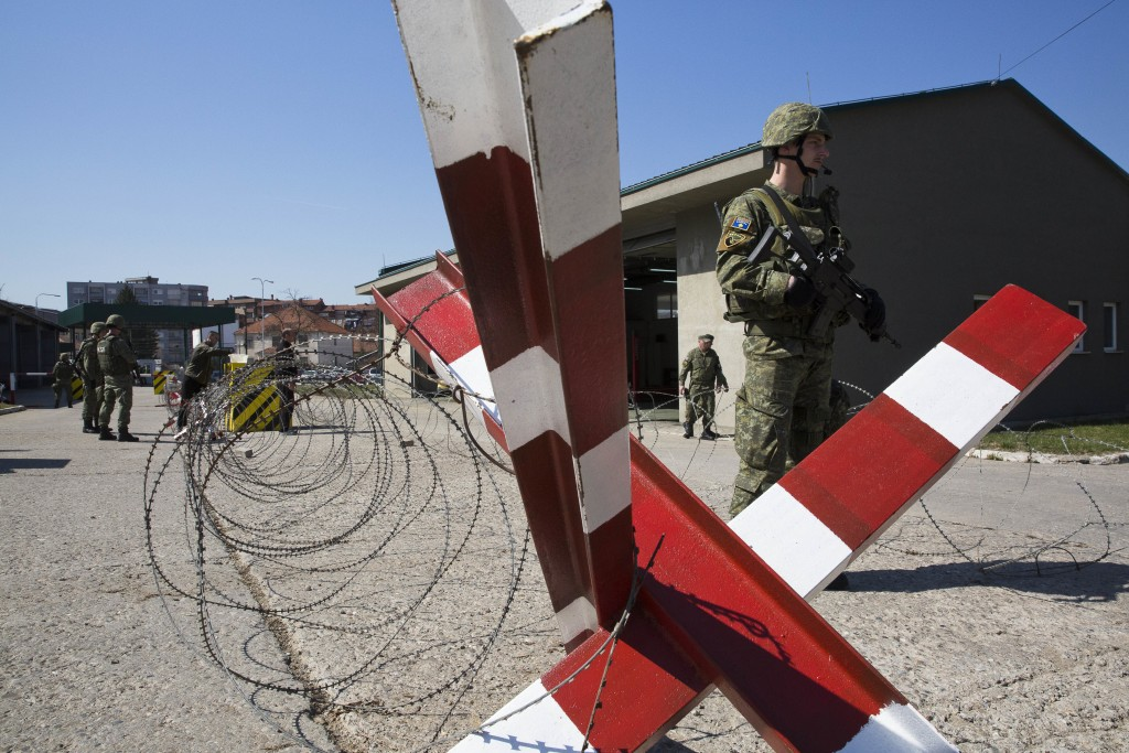In this photo taken on Thursday, March 22, 2018, member of Kosovo Security Force (KSF) man a checkpoint during an exercise inside the barracks in the ...