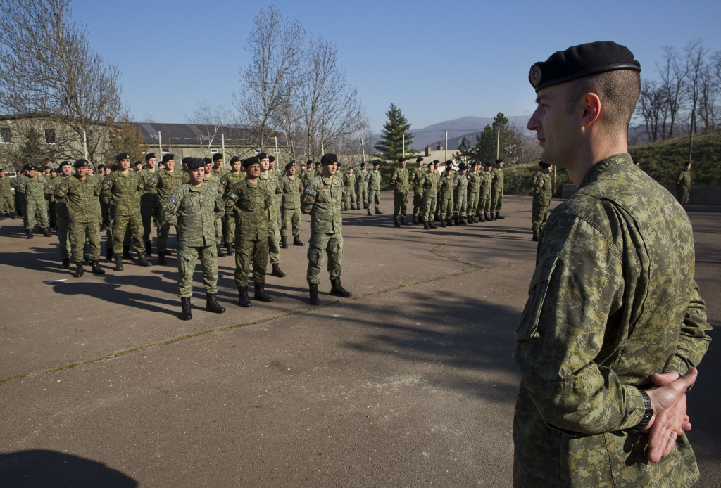 In this photo taken on Thursday, March 22, 2018, members of Kosovo Security Force (KSF) line up for a flag raising ceremony inside the barracks in the...