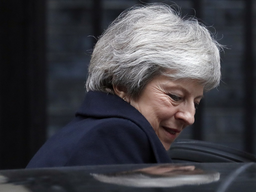 Britain's Prime Minister Theresa May leaves 10 Downing Street to attend the weekly Prime Ministers' Questions session, at parliament in London, Wednes