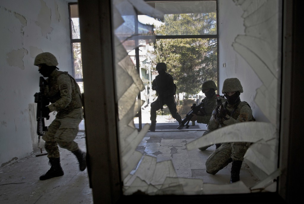 In this photo taken on Thursday, March 22, 2018, member of Kosovo Security Force (KSF) train during hostage rescue exercise inside the barracks in the...