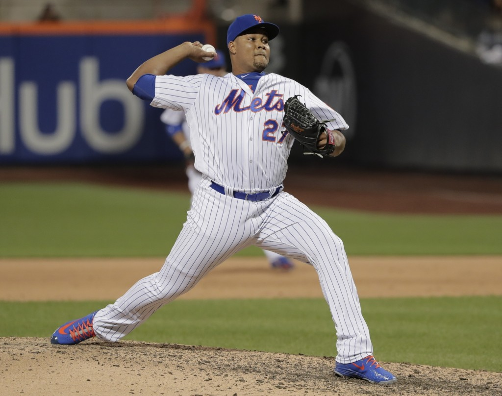 FILE - In this May 18, 2018, file photo, New York Mets pitcher Jeurys Familia (27) delivers against the Arizona Diamondbacks during the ninth inning o...