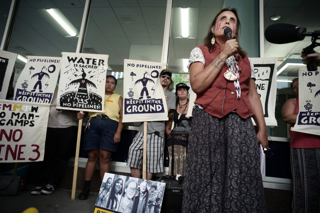 FILE - In this June 28, 2018, file photo, Winona LaDuke speaks out against the Line 3 decision in St. Paul, Minn. Opponents of Enbridge Energy's propo...
