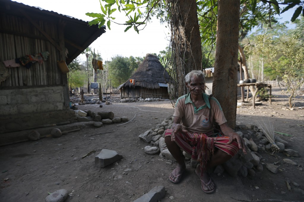 In this Oct. 23, 2018, photo, Laurencius Kollo, great-uncle of Marselina Neonbota, rests outside his home in Fatukoko village in West Timor, Indonesia
