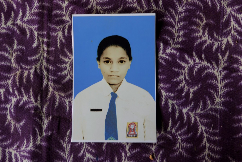 In this Oct. 22, 2018, photo, a photograph of Orance Faot dressed in her school uniform rests on a table in O'of Village in West Timor, Indonesia. Ora...