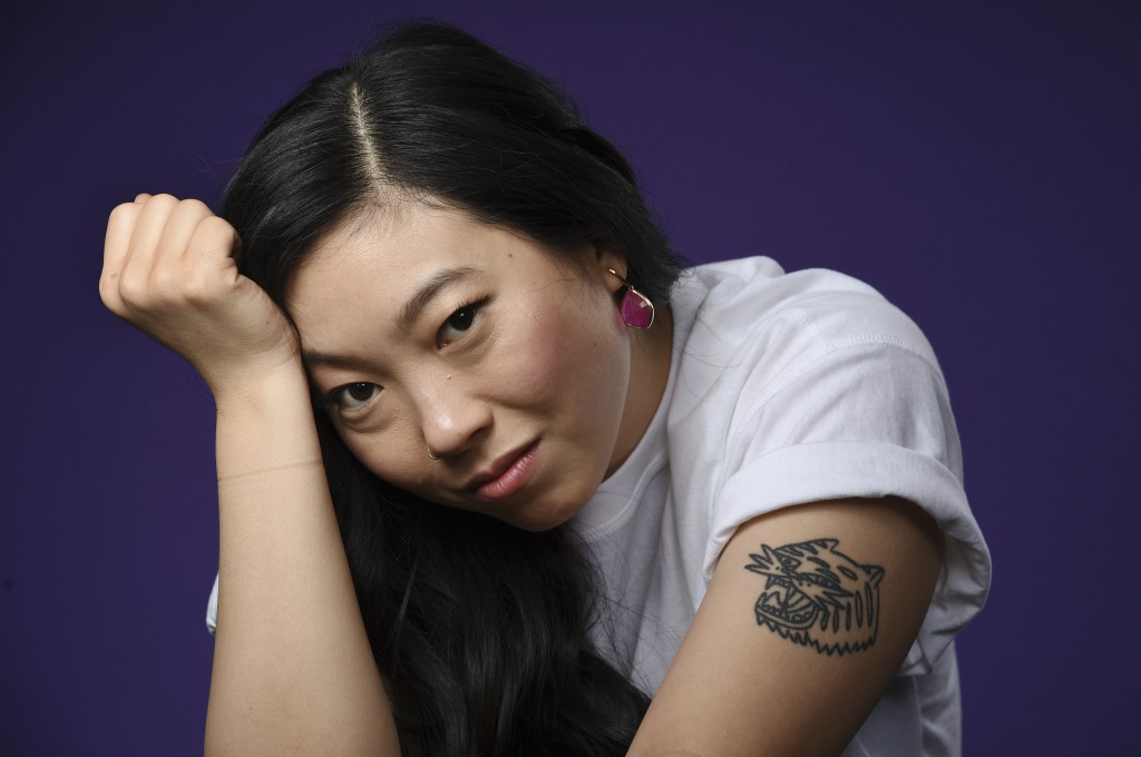 """In this Dec. 5, 2018 photo, actress-rapper Awkwafina poses for a portrait in Los Angeles. Awkwafina, who appeared in the film, """"Crazy Rich Asians,"""" wa..."""