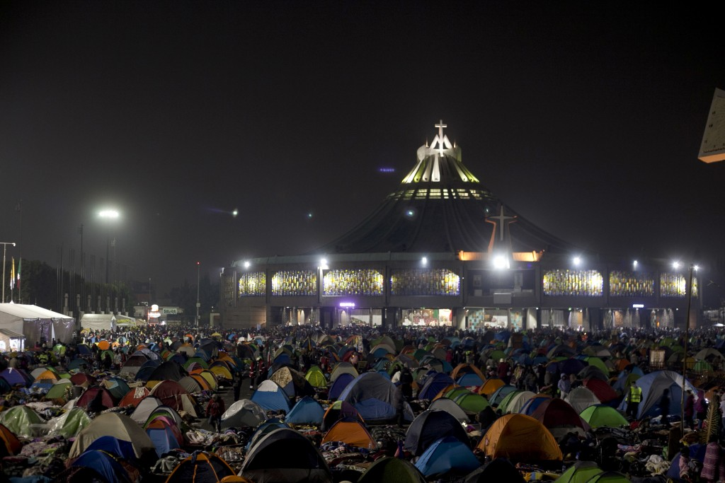 Tents cover the plaza outside the Basilica of Guadalupe in Mexico City, Wednesday, Dec. 12, 2018. Hundreds of thousands of people from all over the co