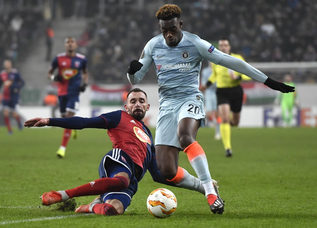 Vidi's Attila Fiola, left, in action against Chelsea's Callum Hudson-Odoi during the UEFA Europa League Group L soccer match between Vidi FC and Chels...