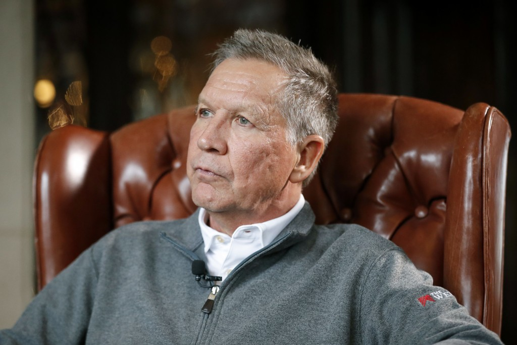 Ohio Gov. John Kasich sits for an interview with The Associated Press at the Ohio Governor's Residence and Heritage Garden, Thursday, Dec. 13, 2018, i