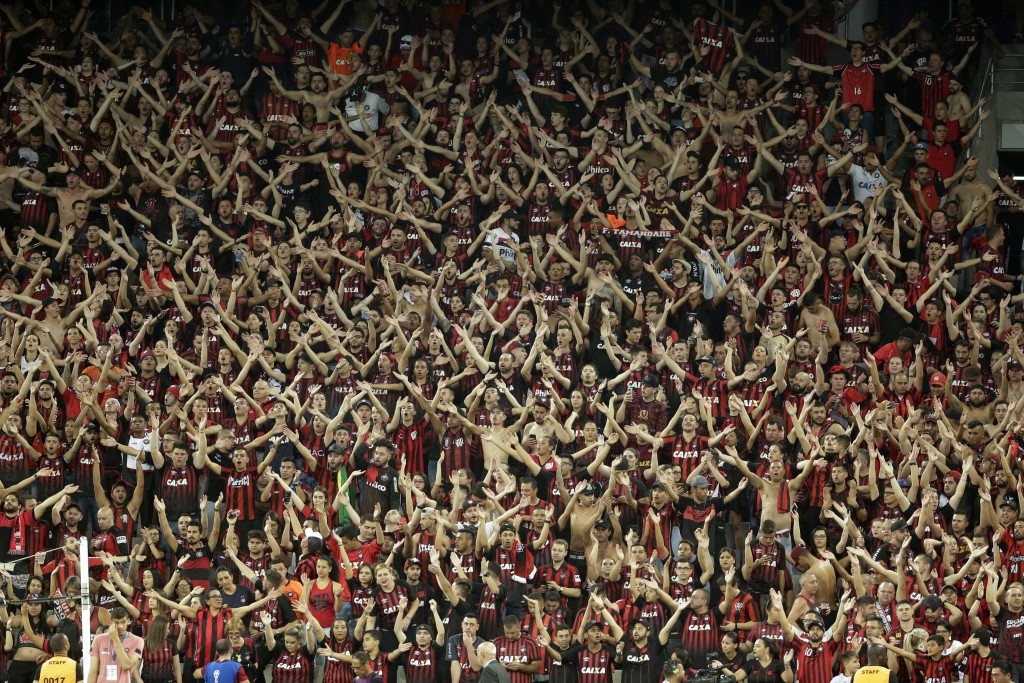 Fans of Brazil's Atletico Paranaense cheer prior to the Copa Sudamericana final soccer match against Colombia's Junior in Curitiba, Brazil, Wednesday,
