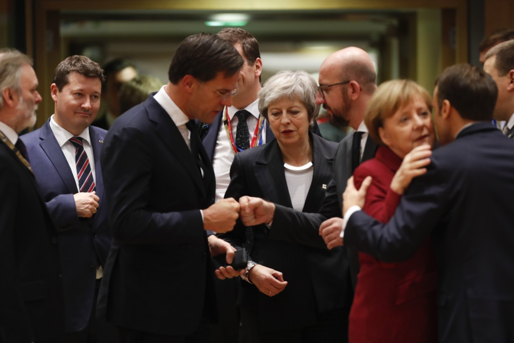 British Prime Minister Theresa May, center, arrives for a round table meeting at an EU summit in Brussels, Thursday, Dec. 13, 2018. EU leaders gathere...