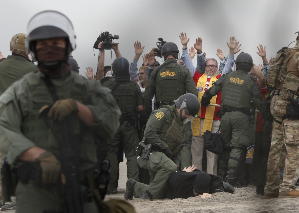 U.S. Border Patrol agents make arrests during a pro-migration protest by members of various faith groups showing support for Central American asylum-s
