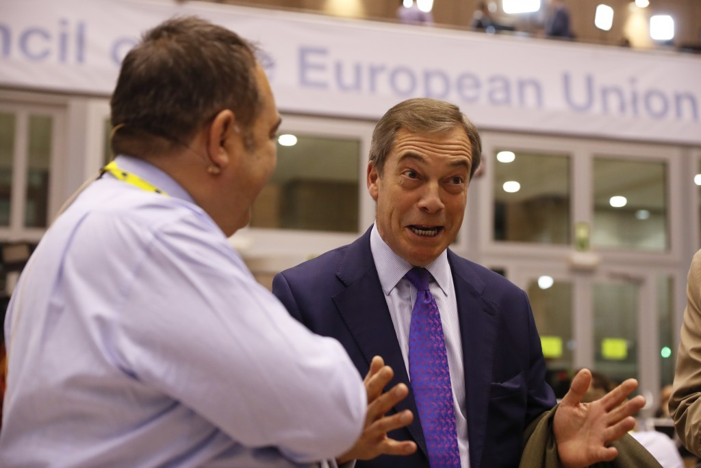 Member of European Parliament Nigel Farage speaks with journalists in the press room at an EU summit in Brussels, Thursday, Dec. 13, 2018. EU leaders ...