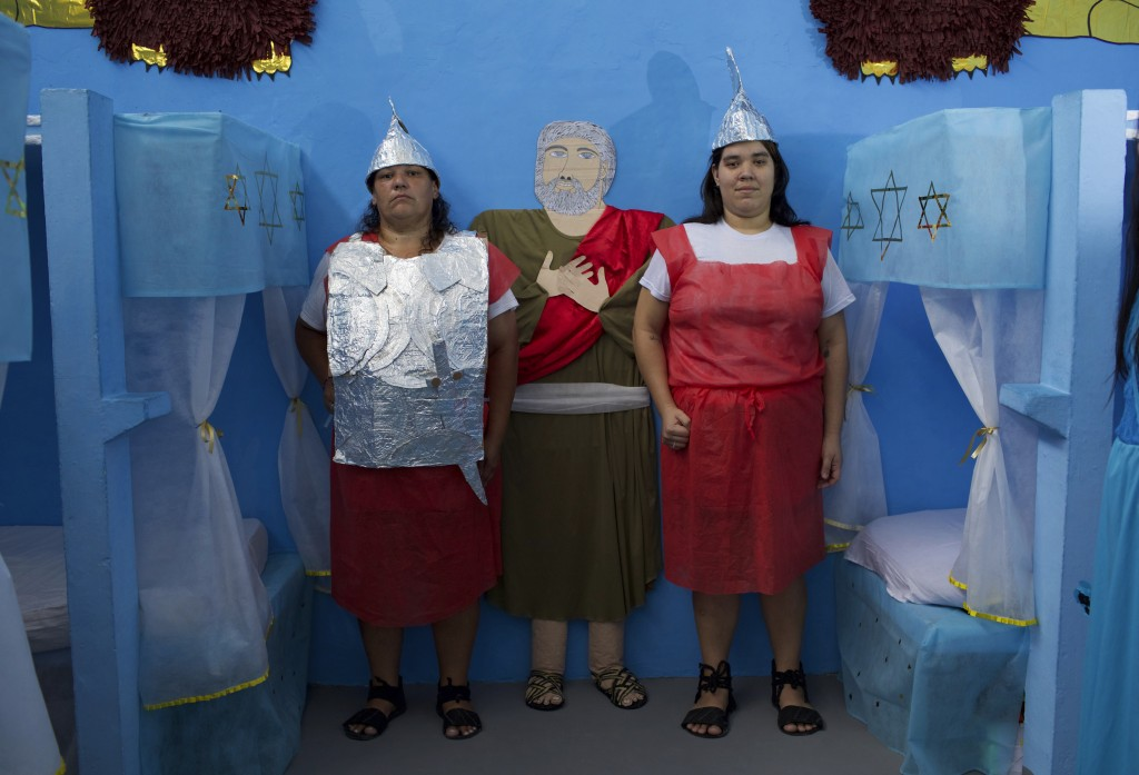 Female inmates dressed as guards pose for a photo during Nelson Hungria Prison's annual Christmas event for inmates and jail staff in Rio de Janeiro,