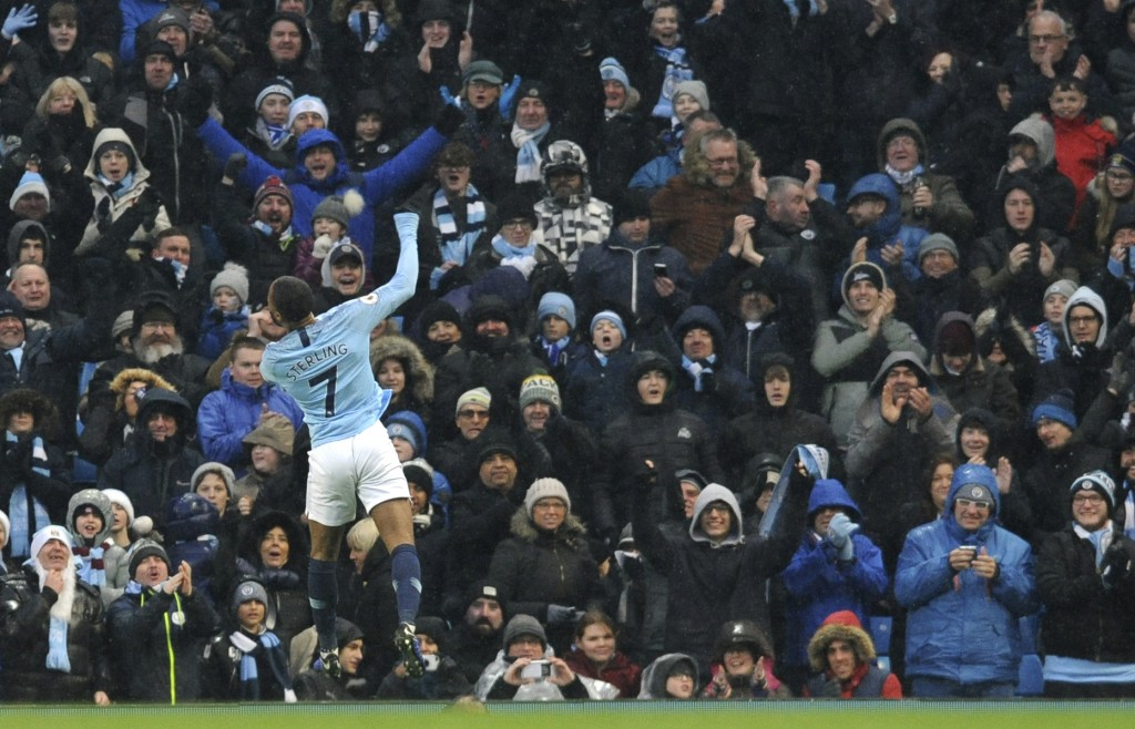 Manchester City's Raheem Sterling celebrates after scoring his sides third goal during the English Premier League soccer match between Manchester City...