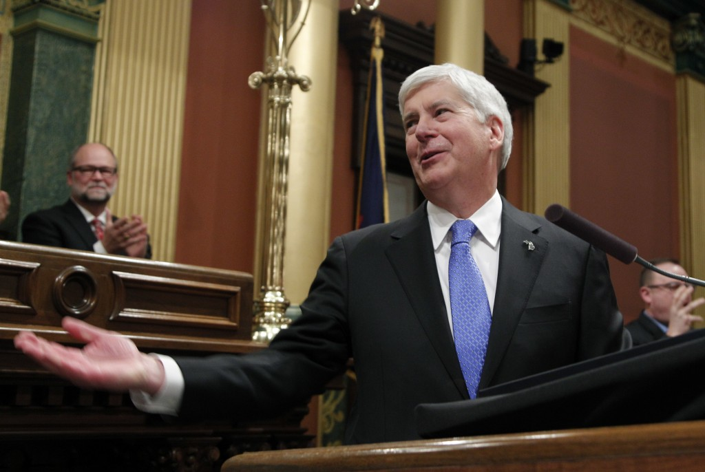 FILE - In this Jan. 23, 2018, file photo, Michigan's Republican Gov. Rick Snyder delivers his final State of the State address at the state Capitol in