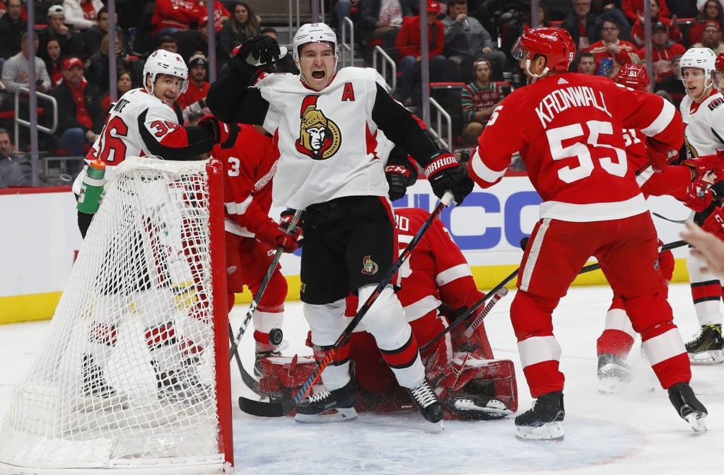 Ottawa Senators right wing Mark Stone (61) celebrates his goal against the Detroit Red Wings in the third period of an NHL hockey game Friday, Dec. 14...