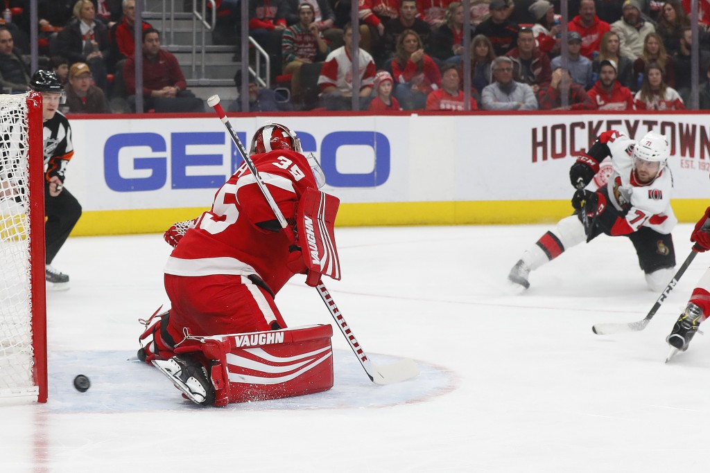 Ottawa Senators center Chris Tierney (71) scores against Detroit Red Wings goaltender Jimmy Howard (35) in the first period of an NHL hockey game Frid